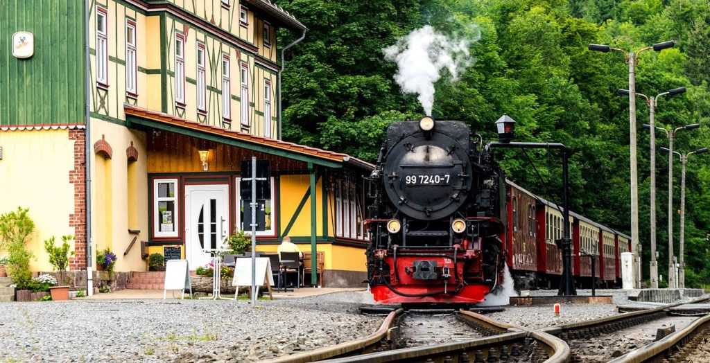 Steam train pulling out of station